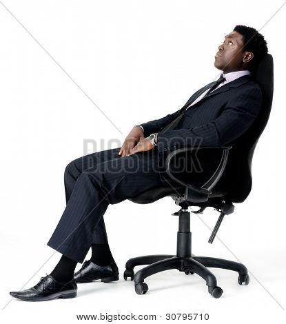relaxed black businessman sitting in office chair isolated on white