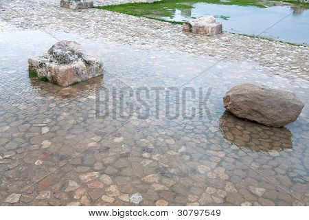 Stone And Column Ruin In Puddle