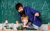 Ready To Success. Using Microscope In Lab. Back To School. Father And Son At School. Student Doing S poster