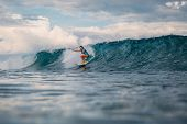 Surf Girl On Surfboard. Woman In Ocean During Surfing. Surfer And Wave poster