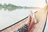 Lifestyle Of Alone Woman,feet Of Hipster Calm People Sleeping And Relaxing In Hammock With Nature Ba poster