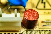 Macro Photography Of Capacitors And Other Electronic Components In An Electronic Board poster