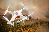 Fire Department Unmanned Aircraft System, (UAS) Drone Isolated Above a Forest Fire. poster