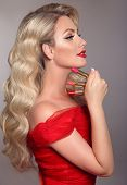 Beauty Makeup. Fashion Glamour Portrait Of Sexy Blonde Woman With Red Lips And Long Wavy Hair Style  poster