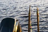 Fishing Rod With The Line And Float Close-up. Fishing Rod In Rod Holder In Fishing Boat Due The Fish poster