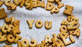 Find You Cookies In The Form Of The Alphabet Prospe Words From Homemade Cookies On Dark White Backgr poster