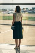 Traveler Girl On Airport In Vacation. Young Traveler Girl In Vacation. Girl Traveling By Airplane In poster