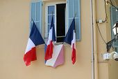French Tricolor Flags On The Town Hall (la Mairie) Of Castellar In France, French Riviera, Europe -  poster