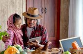 Old Man Grandfather With Hat Explain About His Menu For Cooking To His Grandchild By Using Tablet In poster