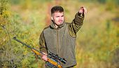 Guy Hunting Nature Environment. Man Bearded Hunter Rifle Nature Background. Hunting Hobby Concept. H poster
