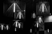 Black And White Photo Of Wire Chandeliers Hanged From Ceiling. Modern Lampshades. Lamp With Long Lig poster