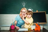 Back To School. Home Schooling Or Private School. Female Teacher And Schoolboy In Class At School. E poster