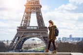 Girl On The Background Of The Eiffel Tower poster