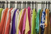 Colorful Clothes On Hangers For Sale In Shop. Summer Season, Assortment In A Clothing Store. Choice  poster