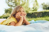Image Of Adorable Blond Little Girl Playing At Nature Background. Happy Child Enjoying Summertime In poster