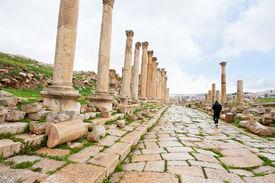 stock photo of cardo  - long colonnaded street or cardo in antique town Jerash in Jordan - JPG
