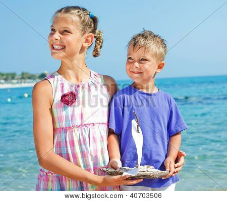 boy and girl with toy ship