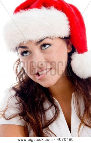 Woman Wearing Christmas Hat And Looking Upward