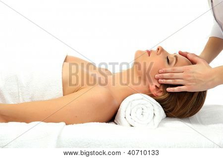 Portrait of beautiful woman taking head massage, isolated on white