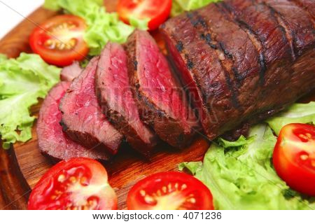 Roast Beef On Wooden Plate