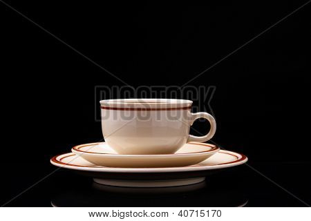 Small cup of coffee on black