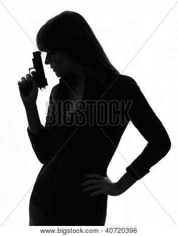 one caucasian sexy detective  woman holding aiming  gun in silhouette studio isolated on white background