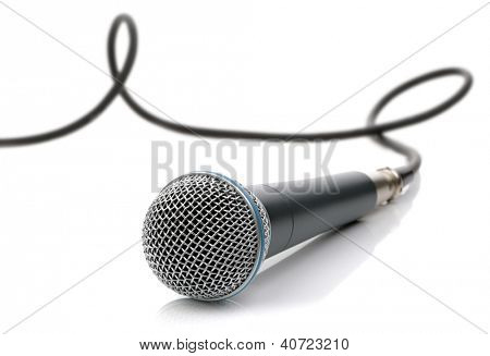 Microphone with cable connected ready for an interview, singing or recording music isolated on white