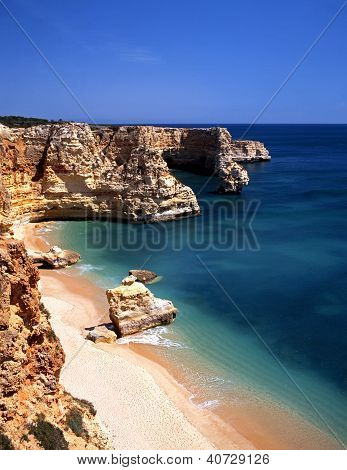 Beach and cliffs, Praia da Marinha, Algarve, Portugal.