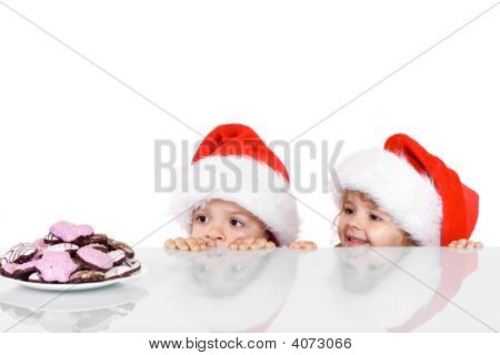 Two Kids Yearning For The Christmas Cookies