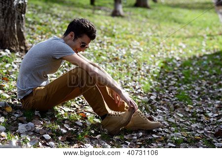Attractive Young Handsome Man, Model Of Fashion Laughing In The Park