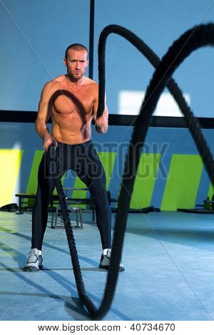 battling ropes at gym workout fitness exercise