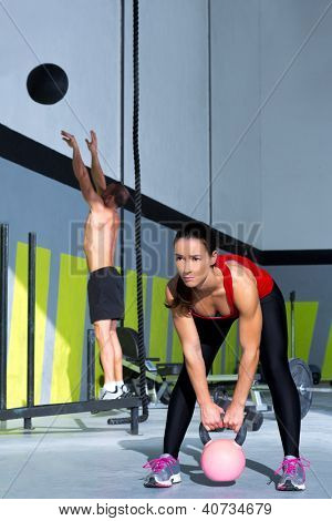gym Kettlebell woman and jumping wall ball man workout at gym