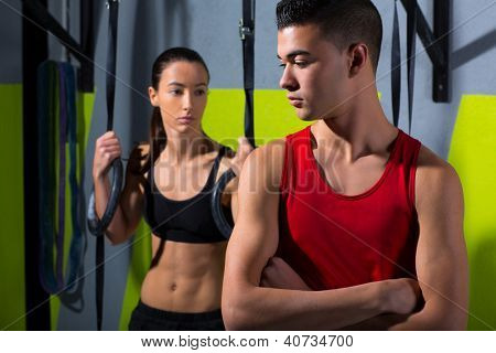 dip ring man and woman relaxed after workout at gym dipping exercise