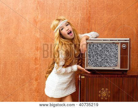 Blond vintage 70s kid girl with retro love old tv on wallpaper
