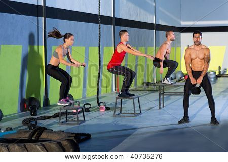 box jump people group and kettlebell man at gym