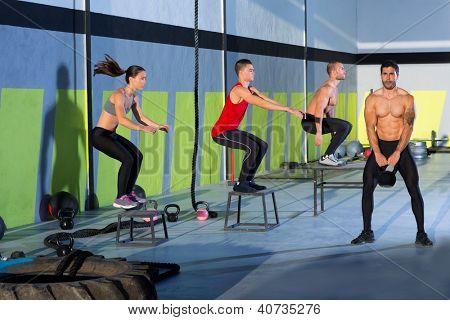 box jump people group and kettlebell man at gym