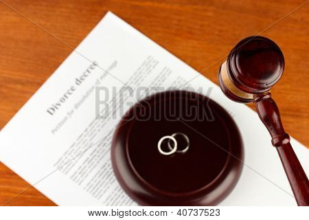 Divorce decree and wooden gavel on wooden background
