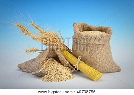 Linguine pasta over sack of wheat