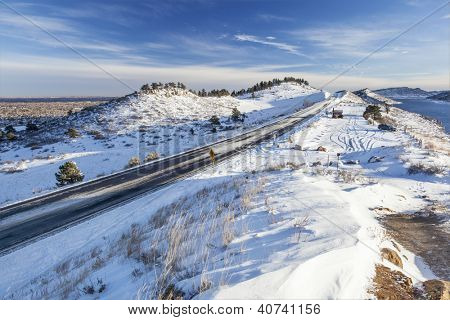 Centennial Road and recreational parking om a shore of Horsetooth Reservoir near Fort Collins, Colorado, winter scenery