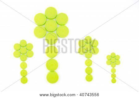 Green Bottle Caps Arranged In Flower Shape