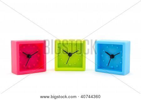 Red, Green, Blue Clocks On White Background
