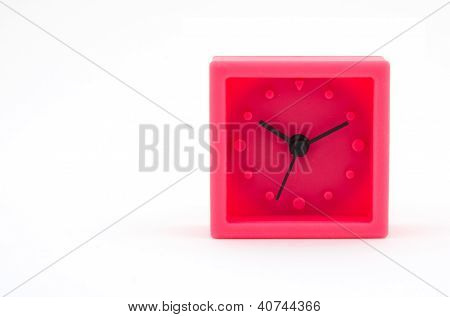 Red Clock On White Background