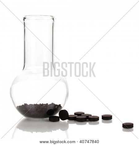 activated carbon in powder and in tablets isolated on white