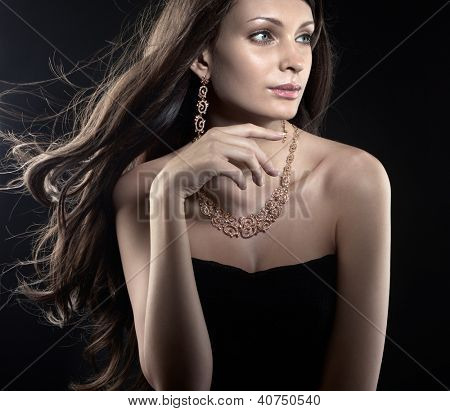 Beautiful woman wearing gold jewellery