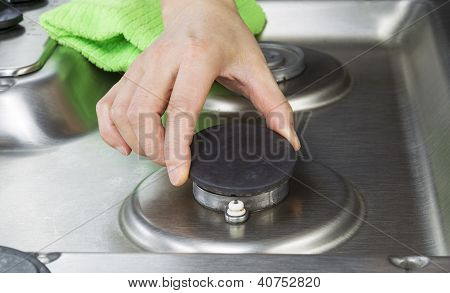 Clean Stove Top Burner Being Maintain