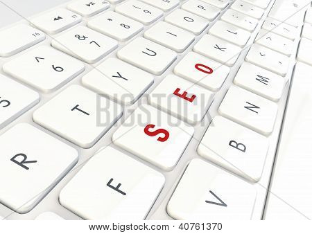 Seo Concept - Word Written On White Shiny Keyboard