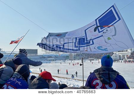Irkutsk,Ru-Feb,26 2012:Team fans with flag on spectator grandstands in Feb,26 2012 in Irkutsk, RU