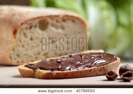 bread with nutella cream on wooden table