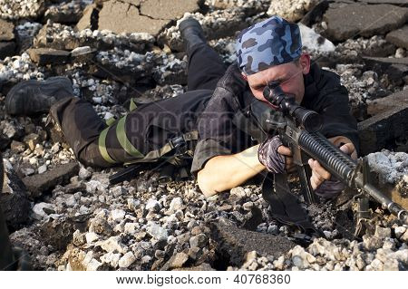 Soldier With A Rifle Aiming The Target