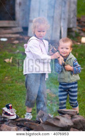 Children Near Campfire